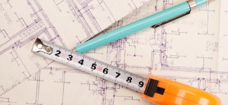 Building drawing with pen and measuring tape